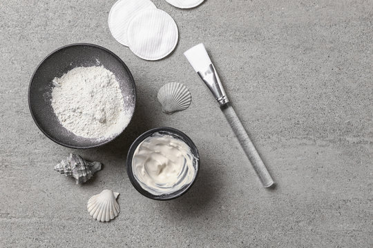 Cosmetic clay with brush on grey table