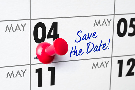 Wall calendar with a red pin - May 04