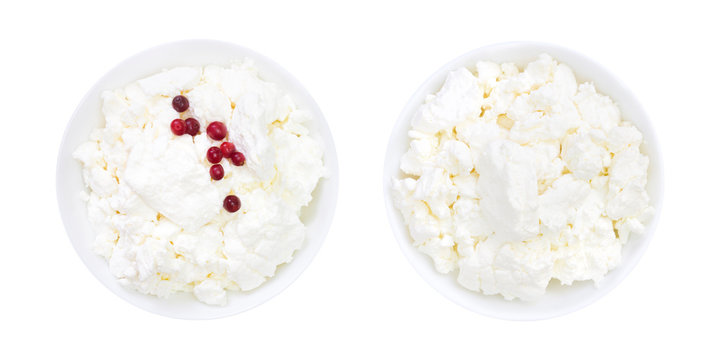 Set of fresh natural cottage cheese with cranberry yogurt in a white ceramic bowl isolated on white. An overhead photo of organic eco healthy meal, dairy product. Top view.