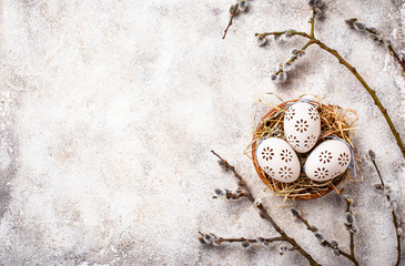 Easter background with willow and eggs