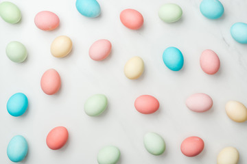 background with colorful pastel easter eggs on white