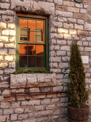 old window in stone wall