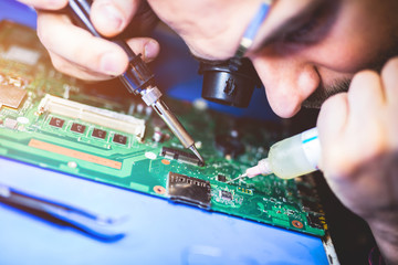 IT worker repairing main board
