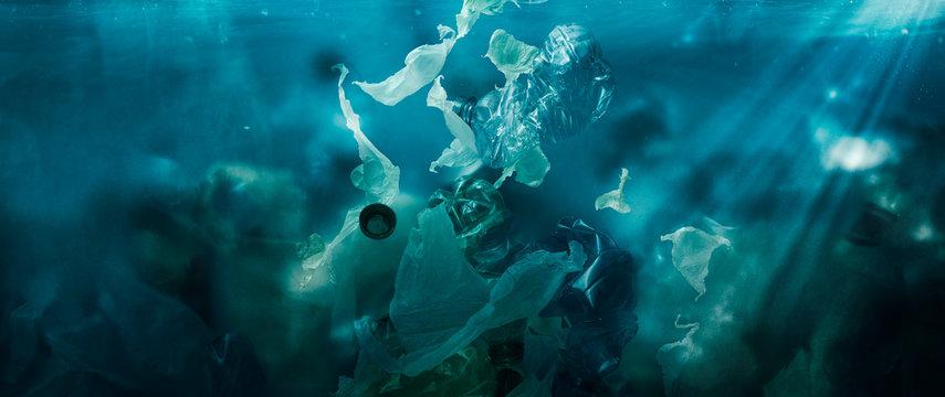 Toxic plastic waste floating underwater in the ocean