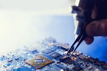 Man putting microchip on the CPU board.