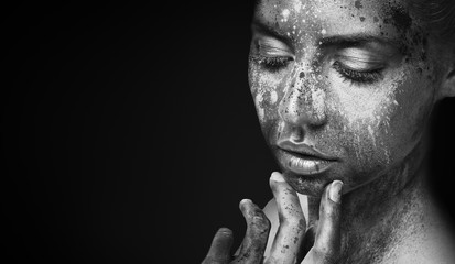 Fashion black and white photo of girl with artistic makeup