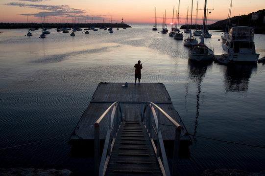 Man fishes at dawn