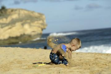 Boy playing on beach at Shipwreck Beach