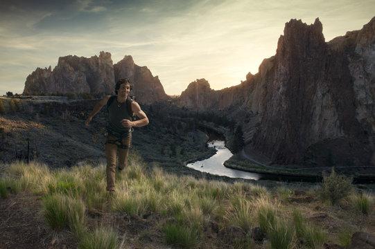Climber running at sunset at Smith Rock, Oregon, USA