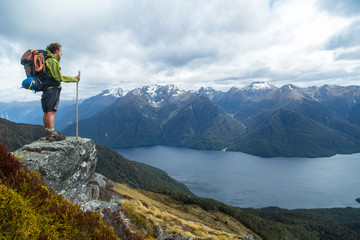 Hiker Exploring Kepler Track In Fiordland National Park, New Zealand