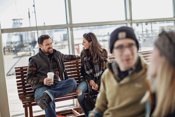 Friends waiting at ferry terminal, Portland, Maine, USA
