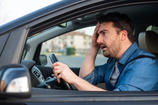 Man driving and feeling bad after car crash