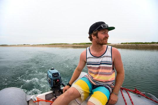Man Riding On Dinghy At Cuttyhunk Harbor