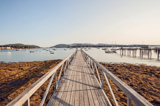 Pier and sailboats at Southwest Harbor, Maine, USA