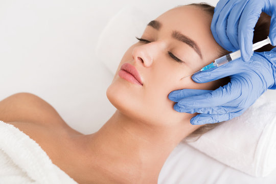 Beauty procedure. Woman receiving hyaluronic acid injection