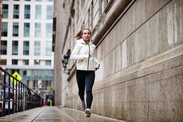 A female runner running through the city