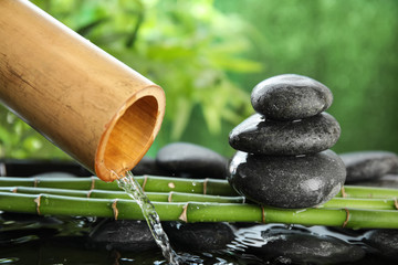 Traditional bamboo fountain with zen stones