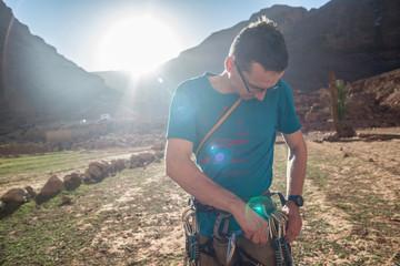 Man preparing before rock climbing, Todra Gorge, Atlas Mountains, Morocco