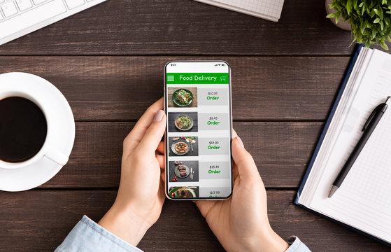Hand touching phone screen for choosing food