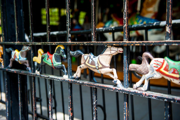 Detail on the fence of the Carousel in Central Park, NYC.