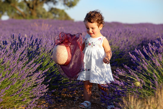 Girl in dress with hat in lavender field