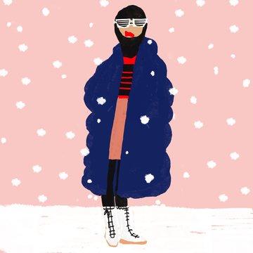 Woman in winter coat in snowfall