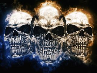 Three angry metal vampire skulls - blue and orange energy clouds around them