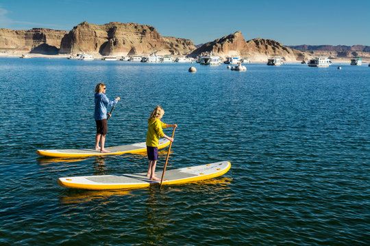 Stand up Paddleboarding on Lake Powell, Glen Caynon National Recreation Area, Page,  Arizona.