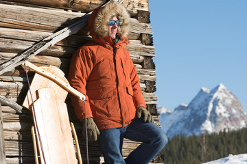 Man leaning outdoors on wooden wall, Silverton, Colorado, USA