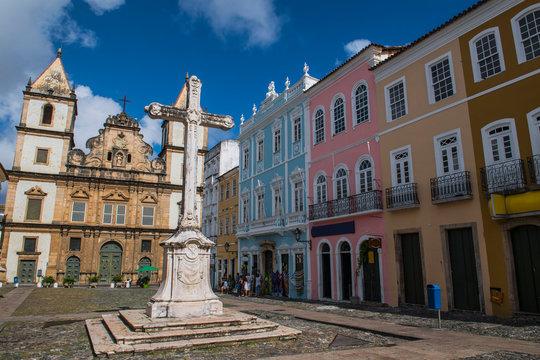 Stone cross in Cruzeiro de Sao Francisco Largo square with Sao Francisco Church and Convent in background, Salvador, Bahia, Brazil