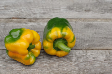 yellow bell peppers on wooden background