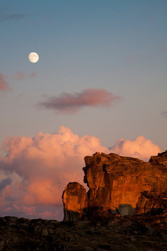 The moon rises over Smokey the Bear, a famous rock formation resembling a bear in Cathedral Lakes Provincial Park, British Columbia, Canada.