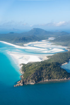 aerial view over whitsunday island beach with blue sunny sky and white sand at whiteheaven beach, australia east coast