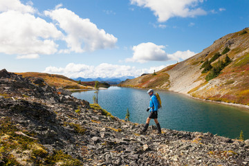 Side view of man hiking in Illal Meadows by lake