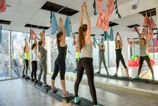 Group of ladies making exercises in gym