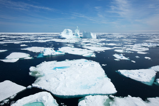 A tourists cruise ship cuts through the ice at Baffin Island, Nunavut, while touring the Canadian arctic.
