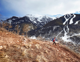 Ben Clark rounds a corner during a trail run above Telluride Colorado during the spring.
