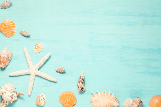 Blue sea background with copy space and seashell border, summer holiday and vacation concept