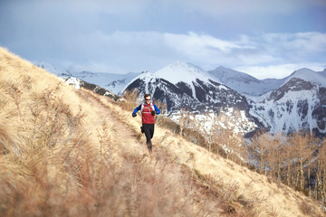 Man trail running in mountains of Telluride, Colorado
