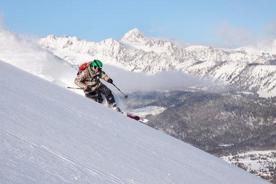 Man skiing in Big Sky Resort in Big Sky, Montana, USA