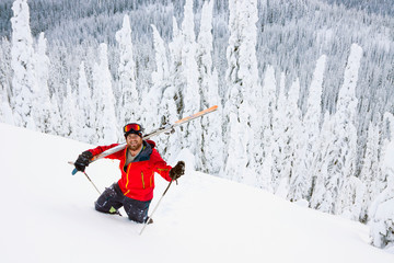Male Skier Hikes Back Up To Hit A Backcountry Ski Jump Near Whitefish, Montana