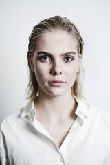 Portrait of blond young woman with wet hair