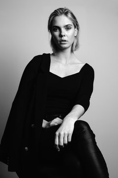 Portrait of blond young woman dressed in black