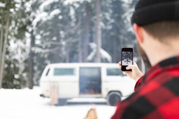 Man taking picture of his van and fire