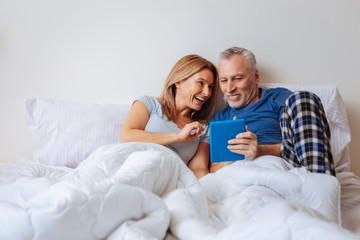 Wife feeling entertained while watching comedy with husband