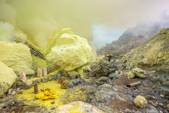 Worker carrying baskets of sulfur at Ijen volcano, Java