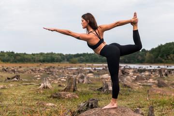 Woman exercising yoga in nature