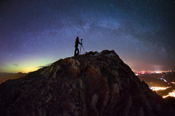 Photographer on Crowsnest Pass at night, Alberta, Canada