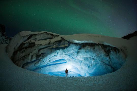 Ice cave under aurora borealis, Athabasca, Alberta, Canada