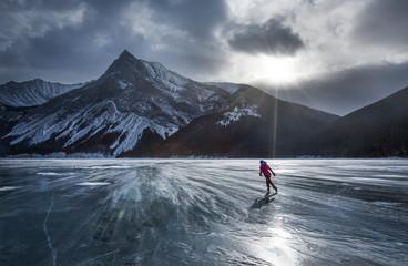 Ice skating at Lake Minnewanka, Banff National Park, Alberta, Canada